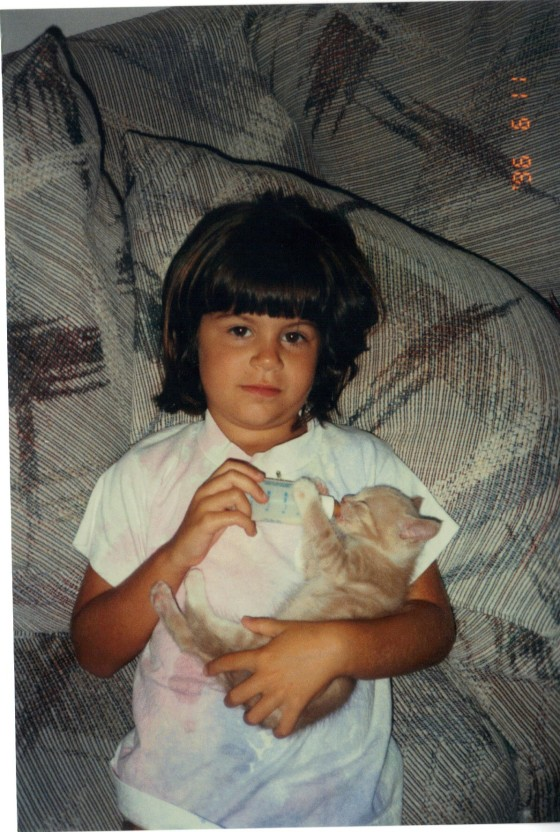 SMILE, BABY MICHELLE, YOU'RE HOLDING A KITTEN.